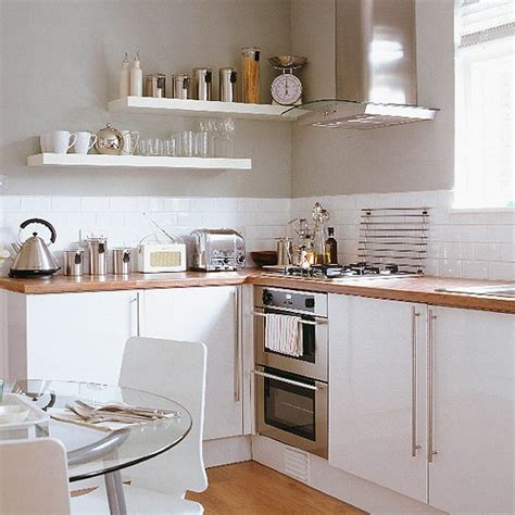 white kitchen ideas photos kitchen diner with white units and glass table housetohome co uk