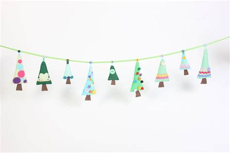 Make Your Own Paper Garland - sew your own tree garland by paper and string