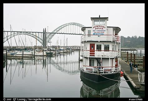 bed and breakfast newport oregon picture photo couple walking on deck next to floating bed and breakfast newport