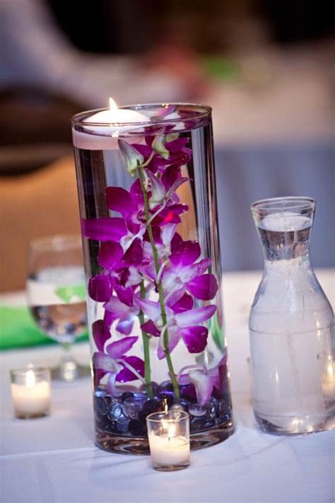 submerged display for wedding orchids centerpieces