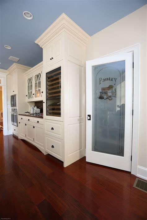 white painted cabinetry etched glass pantry door located longport nj kitchen design churchville kitchen home de longport nj