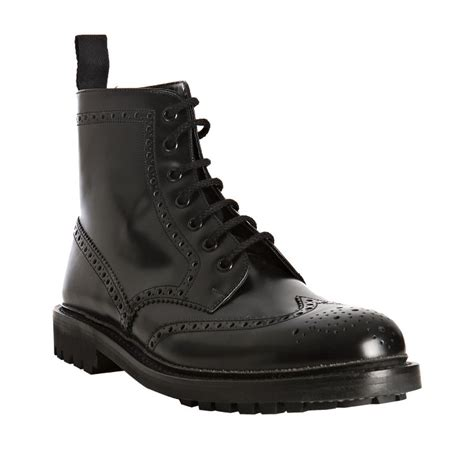 prada black shined leather wingtip ankle boots in black