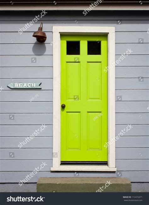 lime green door a bright lime green door with white wood trim in a light
