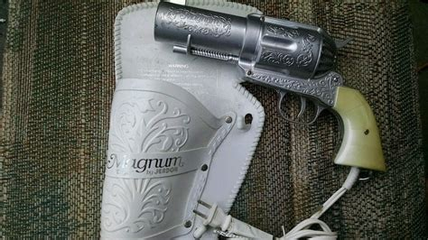 Handgun Hair Dryer vintage hairdryer in the form of a handgun boing boing