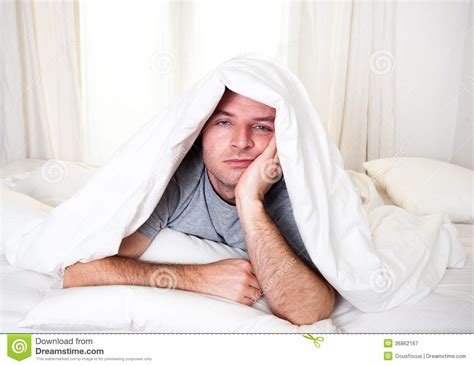 bed eyes man in bed with eyes opened suffering insomnia and royalty free stock photography