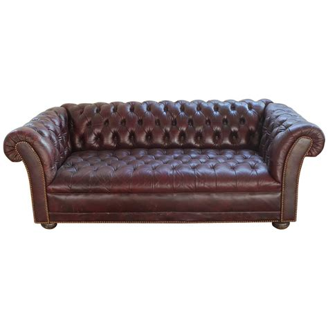 vintage distressed burgundy leather chesterfield sofa at