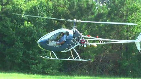 single seat turbine helicopter lands in my yard