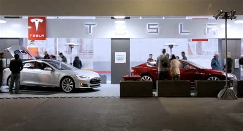 tesla factory owned stores dealers