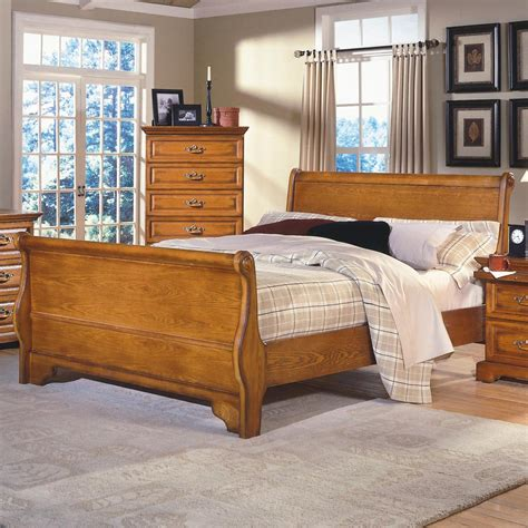 classic honey creek queen oak sleigh bed boulevard home furnishings sleigh bed