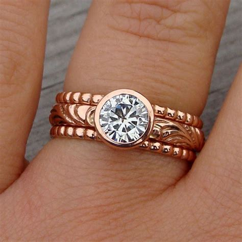 custom made moissanite and recycled 14k gold stacked