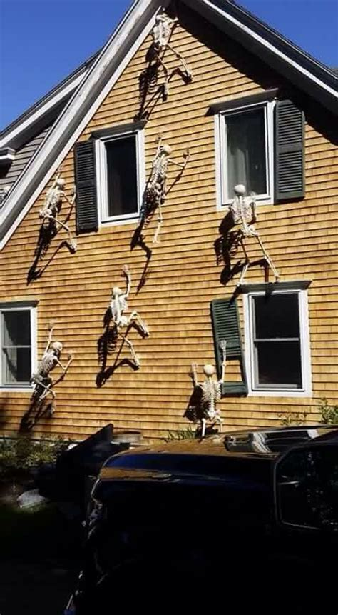 skeletons climbing house halloween decorations with skeletons climbing up the side of the house genius