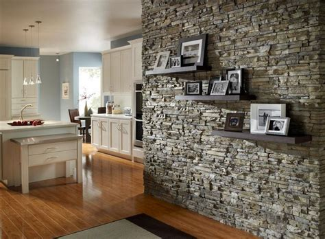 stacked stone accent wall  floating shelves accent