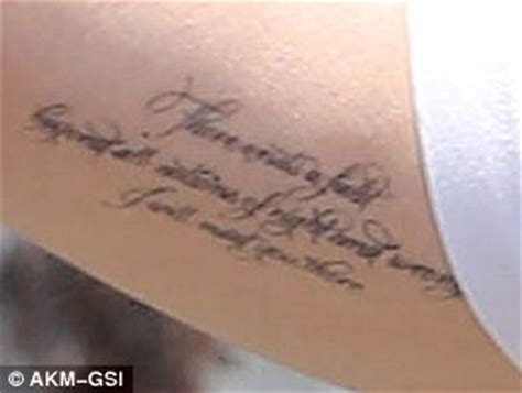 angelina jolie rumi tattoo brad pitt reveals two new tattoos playing ball with
