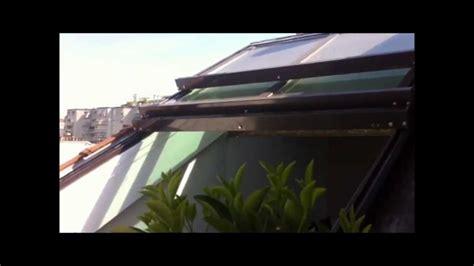 veranda toit 4 pans toiture ouvrante avec vue sur les toits de