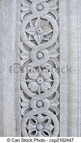 Designer Floor Plans floral pattern carved into a stone royalty free stock