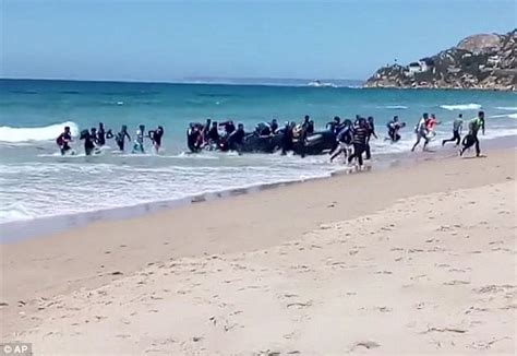 dinghy boat in spanish boat carrying african migrants arrives on spanish beach