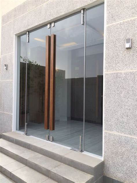 entrance doors with glass glass door with wooden handle architecture