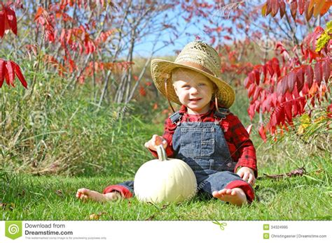 baby country smiling country boy baby in autumn foliage royalty free