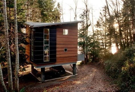 drawbridge style stairs lift up to secure treehouse retreat this low impact cabin is accessed through a hidden