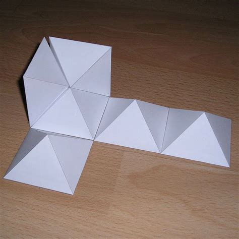Rhombic Dodecahedron Origami - cube into rhombic dodecahedron laser cutting