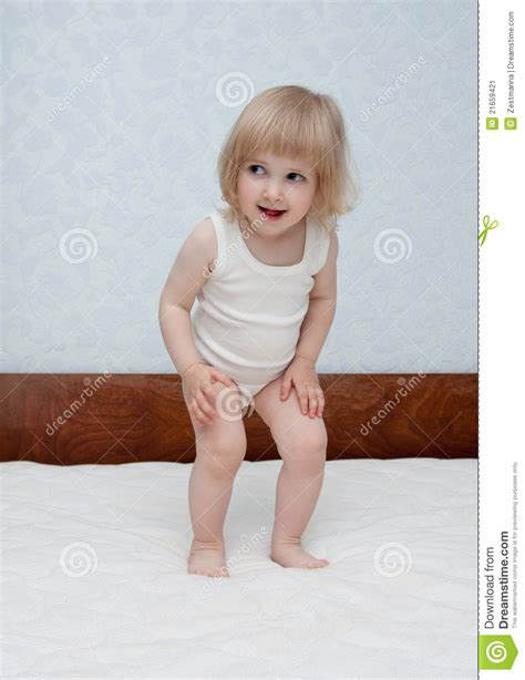 babies jumping on the bed baby is jumping on the bed stock image image 21659421