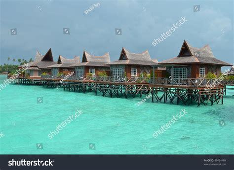 water bungalows in malaysia water bungalows mabul island borneo malaysia stock photo
