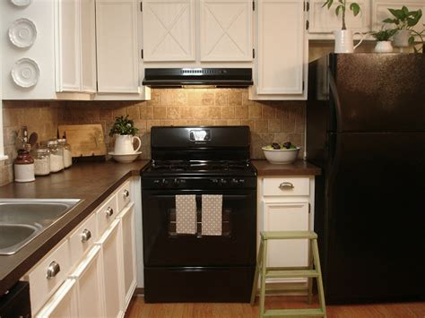 upgrade kitchen cabinet doors update plain kitchen cabinet doors by adding moulding