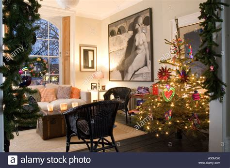 christmas tree and decorations in the living room of a