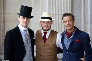 Of victorian fashions pose in their dapper suits top hats and cravats