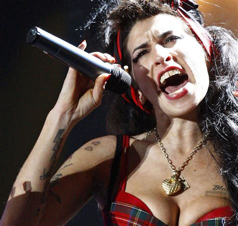 women amy winehouse anchor tattoo women an anchor tattoo meaning amy winehouse tattoos pictures images pics photos of her