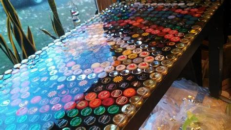acrylic bar top resin bottle cap table with poured resin surface