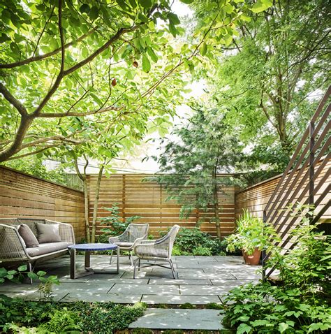 landscape architect visit a leafy garden in park slope in