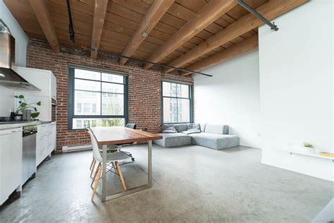 modern industrial vancouver apartment  wood concrete  brick