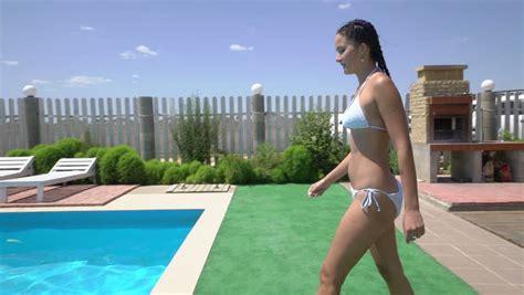 back yard teens bikinis young woman walking out of swimming pool stock footage