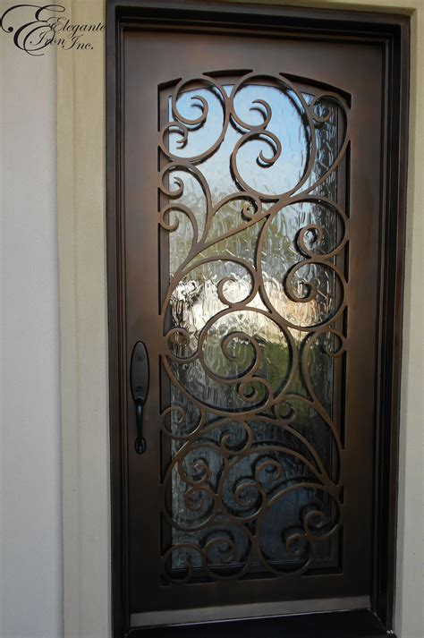 Handcrafted Doors - custom wrought iron front door home ideas