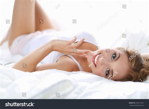 lie on the bed beautiful young woman lying on bed stock photo 326413181