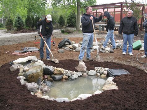 how to build a pool waterfall brownsburg business teaches diyers with a hands on pond