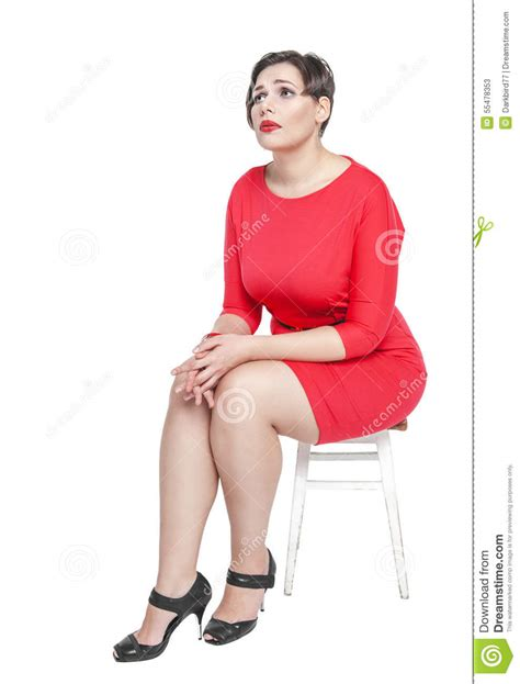 Sitting Size M sad plus size sitting on the chair isolated stock