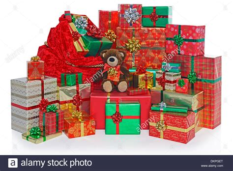 a sack and group of gift wrapped christmas presents with a