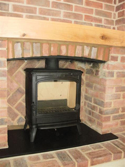 Brick Fireplace Surround Designs by Brick Surround With Wooden Beam And Wood Burner