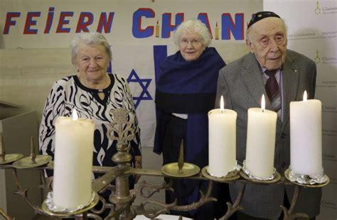 holocaust survivors worldwide celebrate hanukkah with