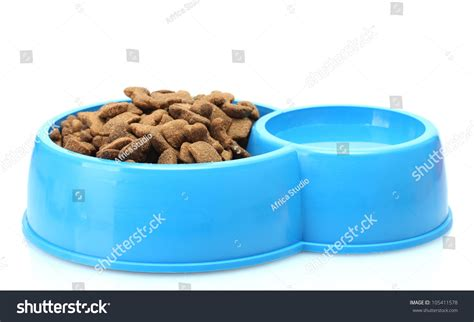 when do puppies start food and water food and water in blue bowl isolated on white stock photo 105411578