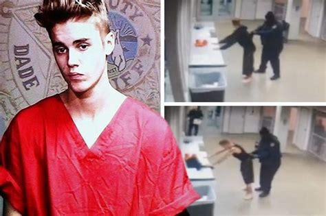 justin bieber s eyes when arrested justin bieber jail video cops frisk pop star after arrest