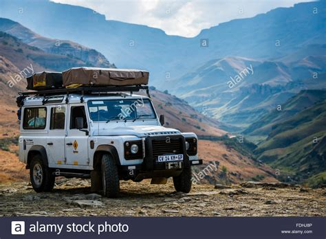 land rover africa land rover defender parked with mountains in the