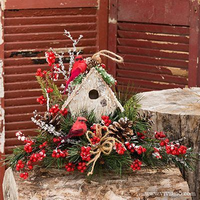christmas arangemts fyi winter song 37416 see viviano centerpiece with cardinal birds and birdhouse in