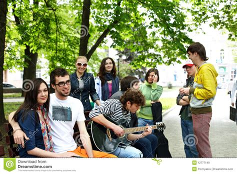 park bench group group of people on bench in park royalty free stock