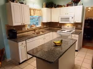 Home Decor Distributors caledonia granite for white cabinets traditional