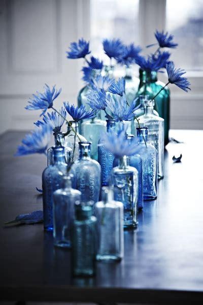 blue centerpieces blue bottle flower wedding centerpiece once wed