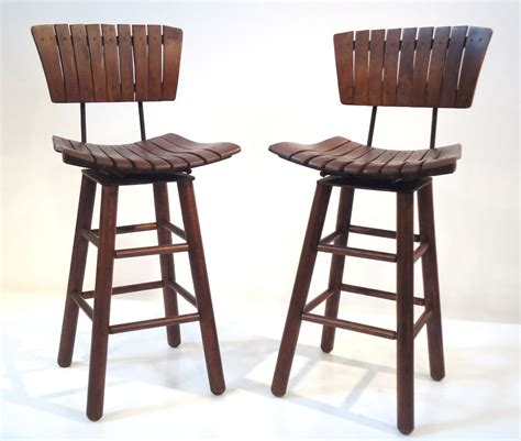restaurant swivel bar stools pair of rustic swivel bar stools with backs at 1stdibs