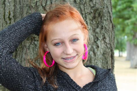 Female Teenager Teenager And Her Wild Pink Earrings Jenn Durfey Flickr